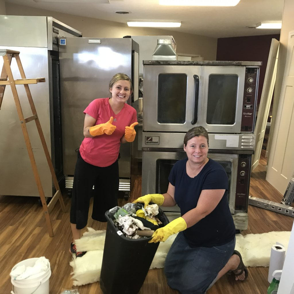 Larissa And Jody Working On Scrubbing Down An Older Oven