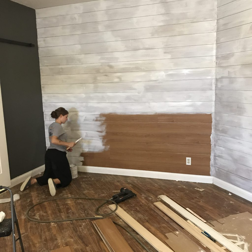 Larissa Working On Painting A Shiplap Wall That Mike Put Up. The Wall Used To Be A Deep Red.